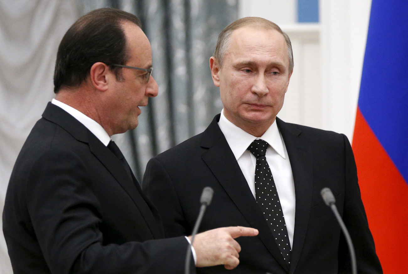 Russia's President Vladimir Putin and his French counterpart Francois Hollande speak after a news conference at the Kremlin in Moscow, Russia, November 26, 2015.