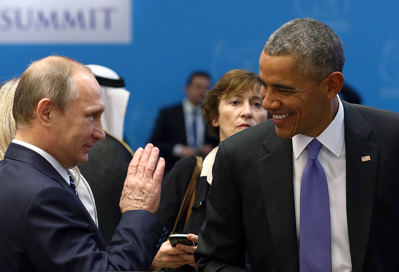 U.S. President Barack Obama (R) chats with Russia's President Vladimir Putin prior to a working session at the Group of 20 (G20) leaders summit in the Mediterranean resort city of Antalya, Turkey.