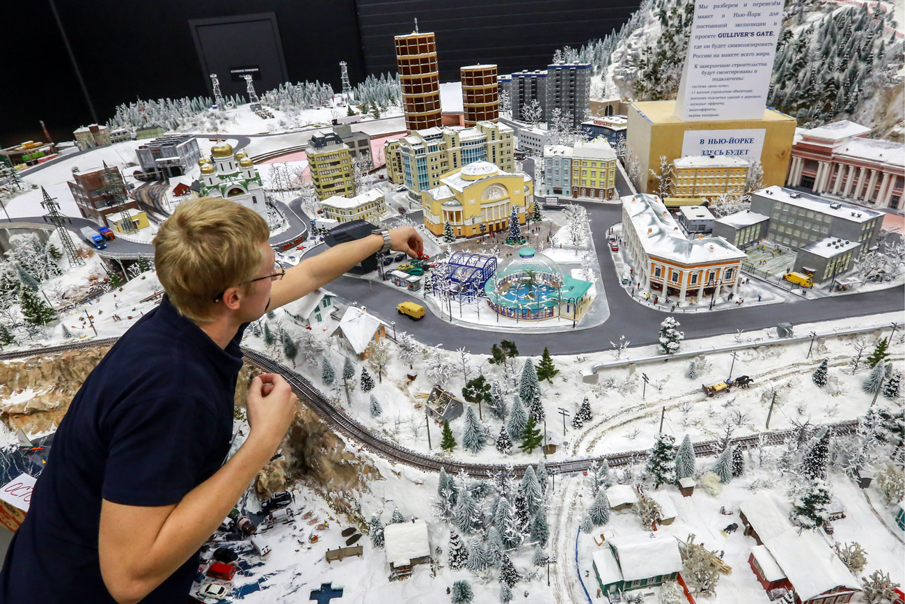 ST PETERSBURG, RUSSIA - OCTOBER 10, 2016: A worker of the Grand Maket Rossiya museum prepares a miniature version of the Russian Federation to be displayed. The mockup makes the largest part of the Gulliver's Gate project creating a 1:87 scale miniature version of the world. Gulliver's Gate is to open in April 2017 in Times Square, New York City.
