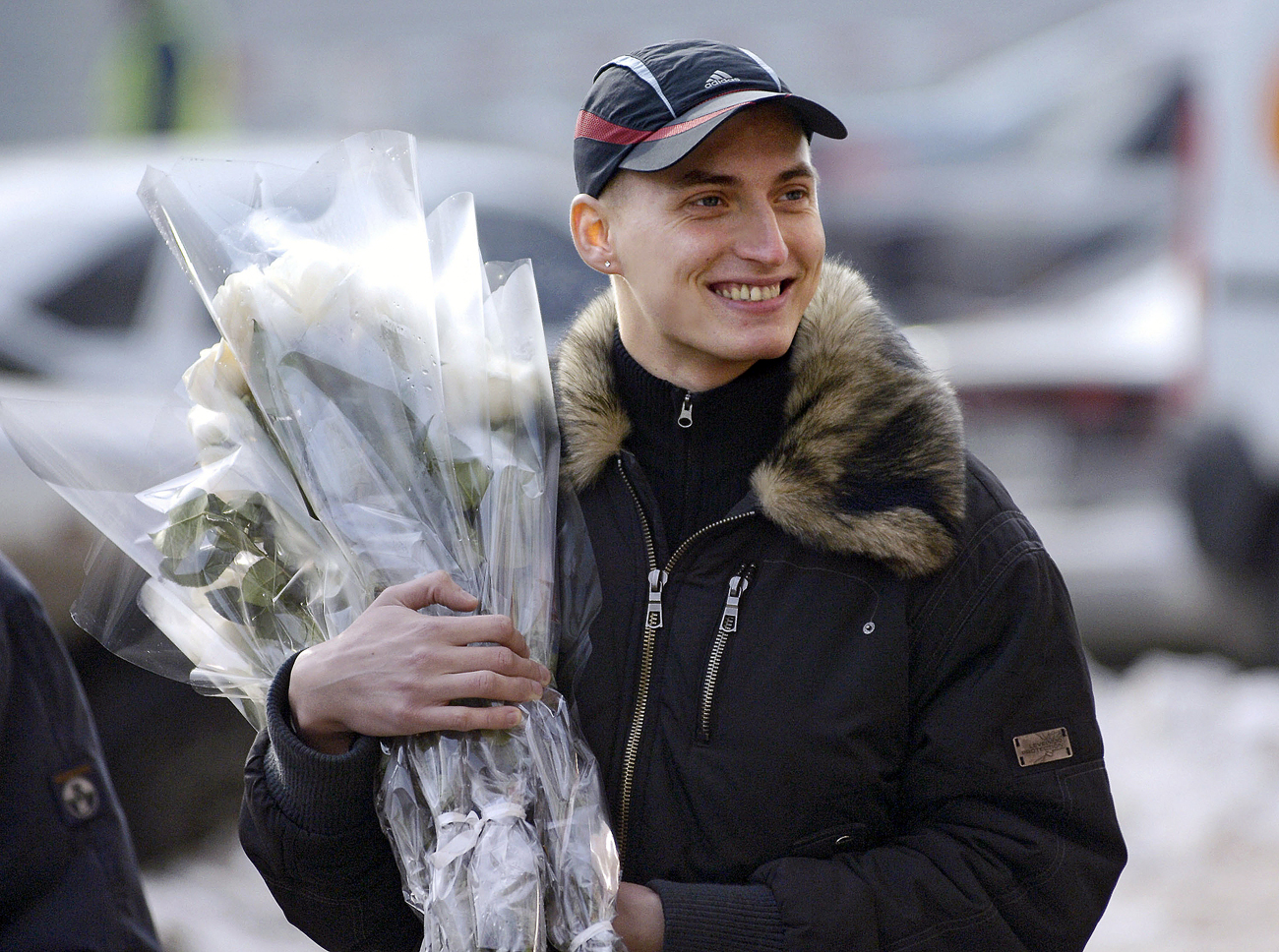 Men buy flowers on the eve of March 8, International Women's Day.