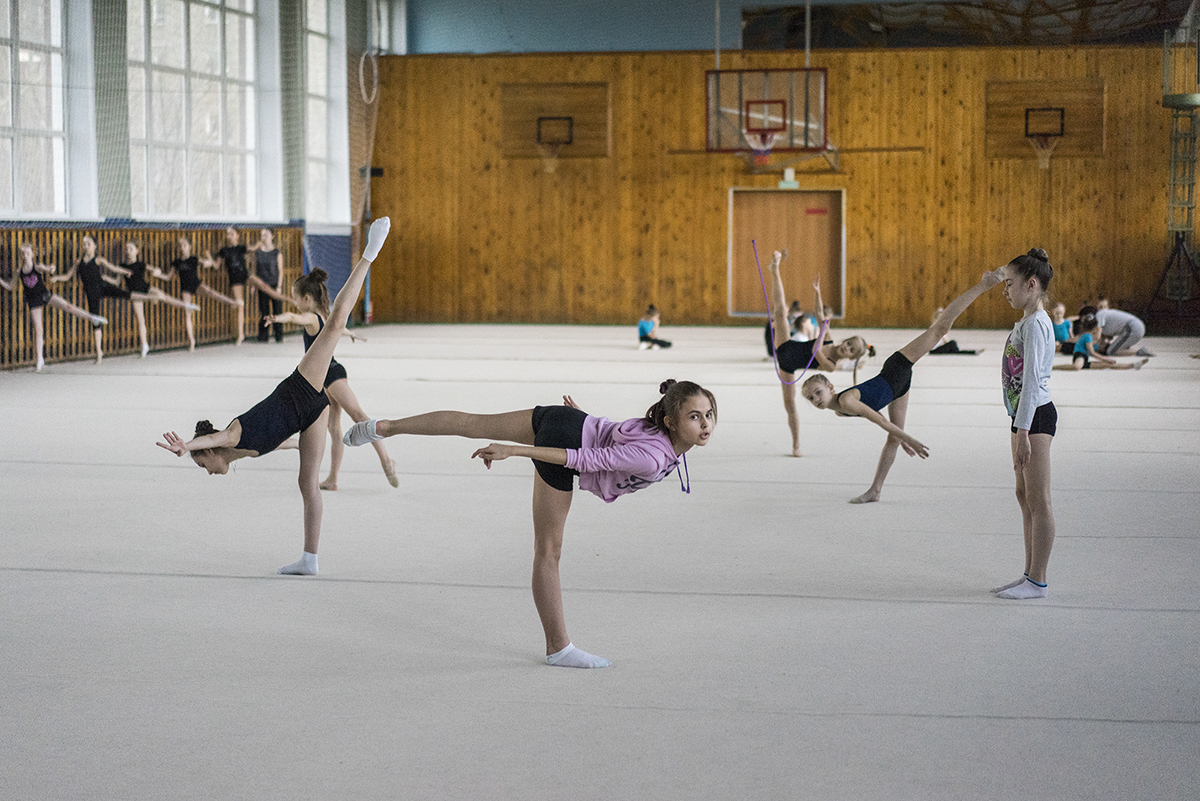 "As usually seen from the other side, rhythmic gymnastics is a harmonious blend of art and dance. ""This sport emphasizes femininity in girls, which is also inherent in Russian culture itself,"" according to the photographer Maria Babikova."