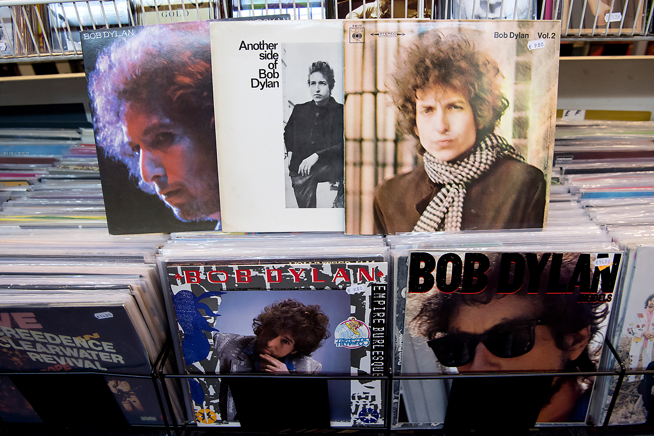 The records 'At Budokan', 'Another side of Bob Dylan', 'Blonde on Blonde, 'Emprie Burlesque' (bottom-C) and 'Infields' (bottom-R) by US singer-songwriter Bob Dylan lie in a record store in Munich, Germany. Dylan won the 2016 Nobel Prize in Literature, the Swedish Academy announced in Stockholm on Oct.13, 2016.