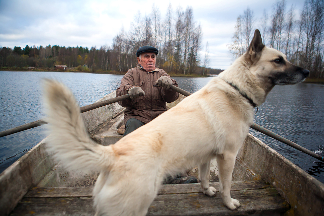 "Karelia, northern Russia, Oct. 14, 2016. Vasily Diykov, one of the main defenders of the Sunsky Forest, on his way by boat to the camp of the so-called ""Sunskye partizany"" (Sunsky guerillas) in the Kondopoga district. The ""Sunskye partizany"" are seniors from the Karelian village of Suna who have organized in the forest a  round-the-clock camp to protect the forest from being cut down by the Saturn Nordstroi company."