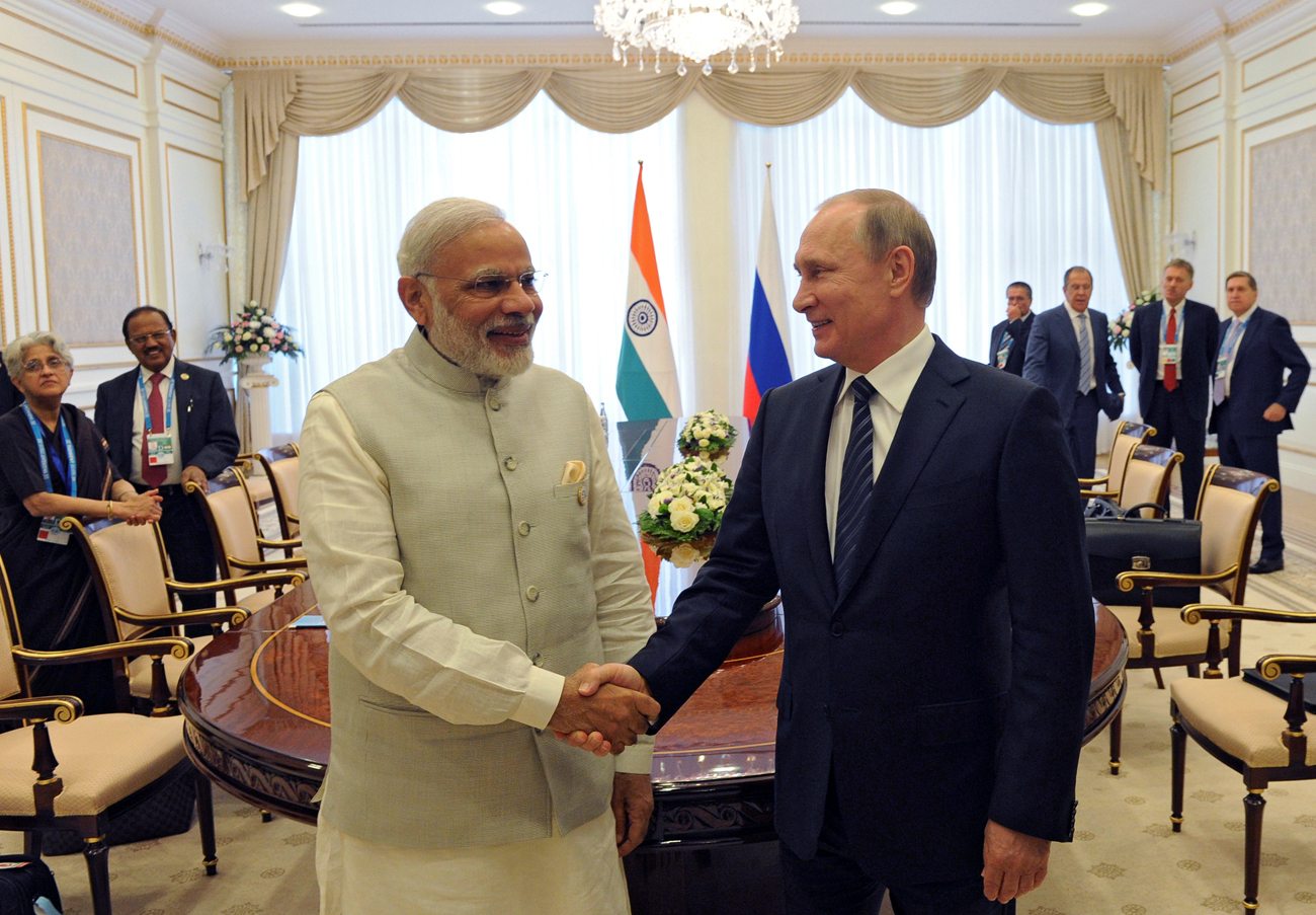 Russian President Vladimir Putin shakes hands with Indian Prime Minister Narendra Modi, June 24, 2016.