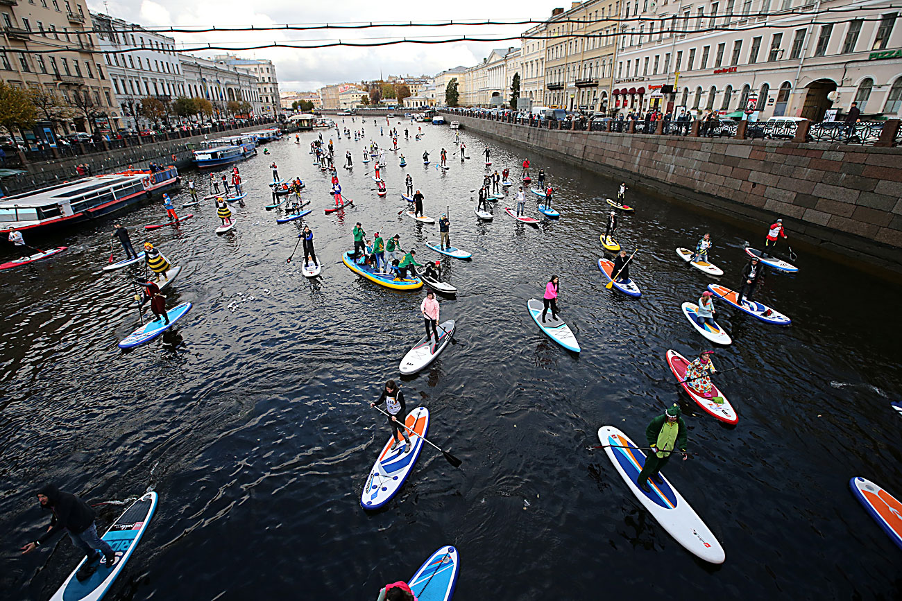 "ST PETERSBURG, RUSSIA - OCTOBER 15, 2016: Participants in the 1st Stand up paddle surfing festival ""Fontanka-SUP."""