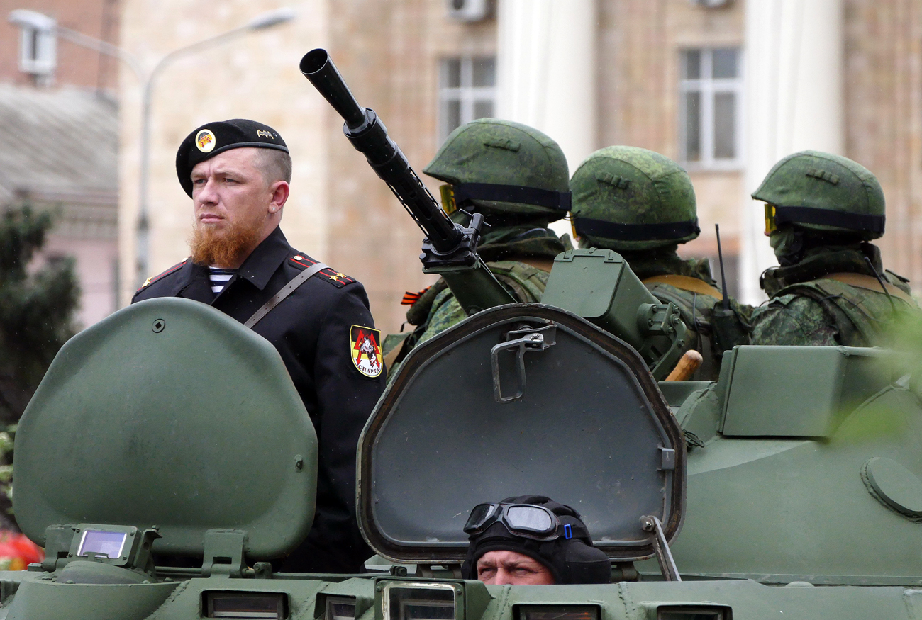 Arseny Pavlov (left), also known as 'Motorola', during the rehearsal of the military parade in Donetsk.