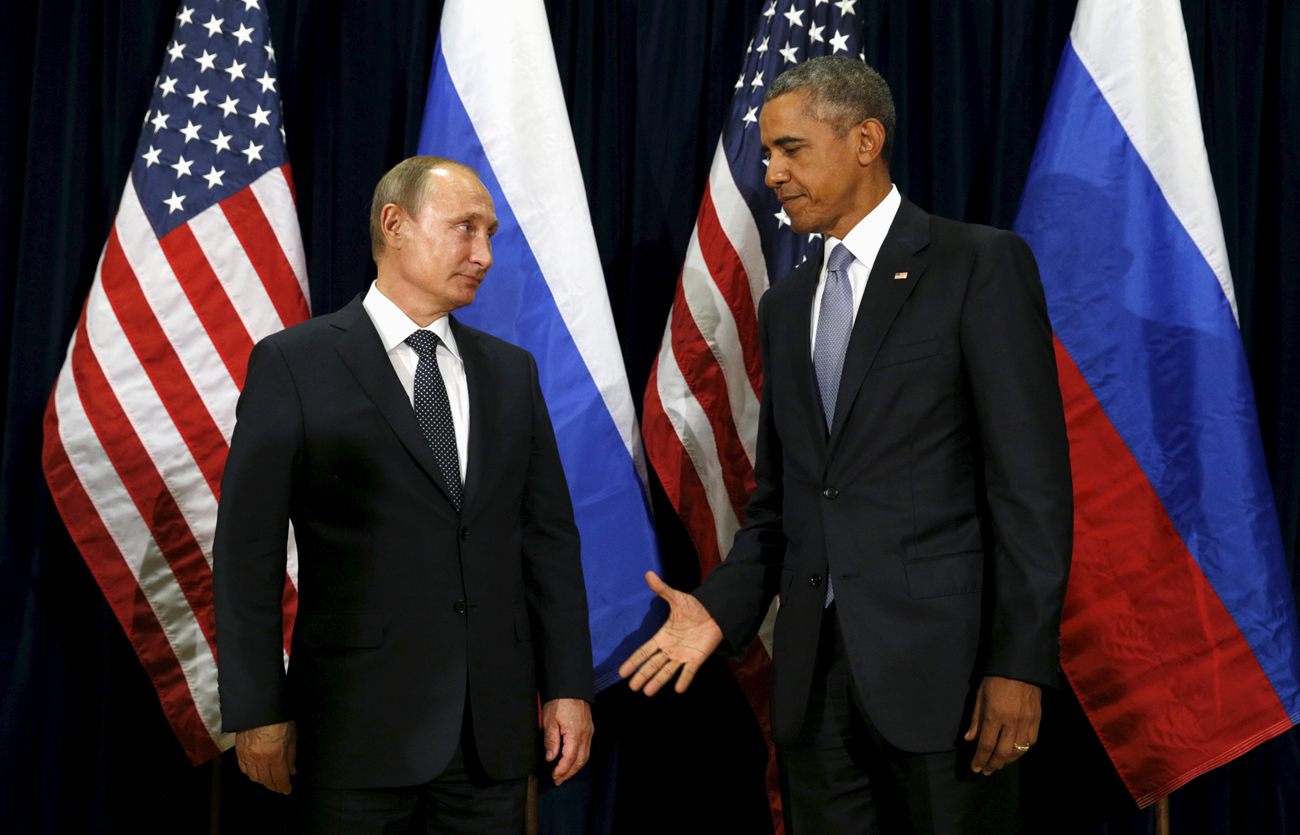 U.S. President Barack Obama extends his hand to Russian President Vladimir Putin during their meeting at the United Nations General Assembly in New York on Sept. 28, 2015.