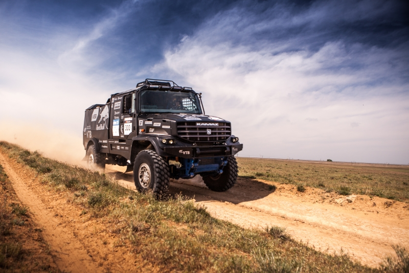 "The new KAMAZ model will be easily recognizable due to its unusual color. Instead of the usual bright-blue hues that gave the team its nickname ""Blue Armada,"" the new truck is dressed in a monochrome black ""tuxedo."""