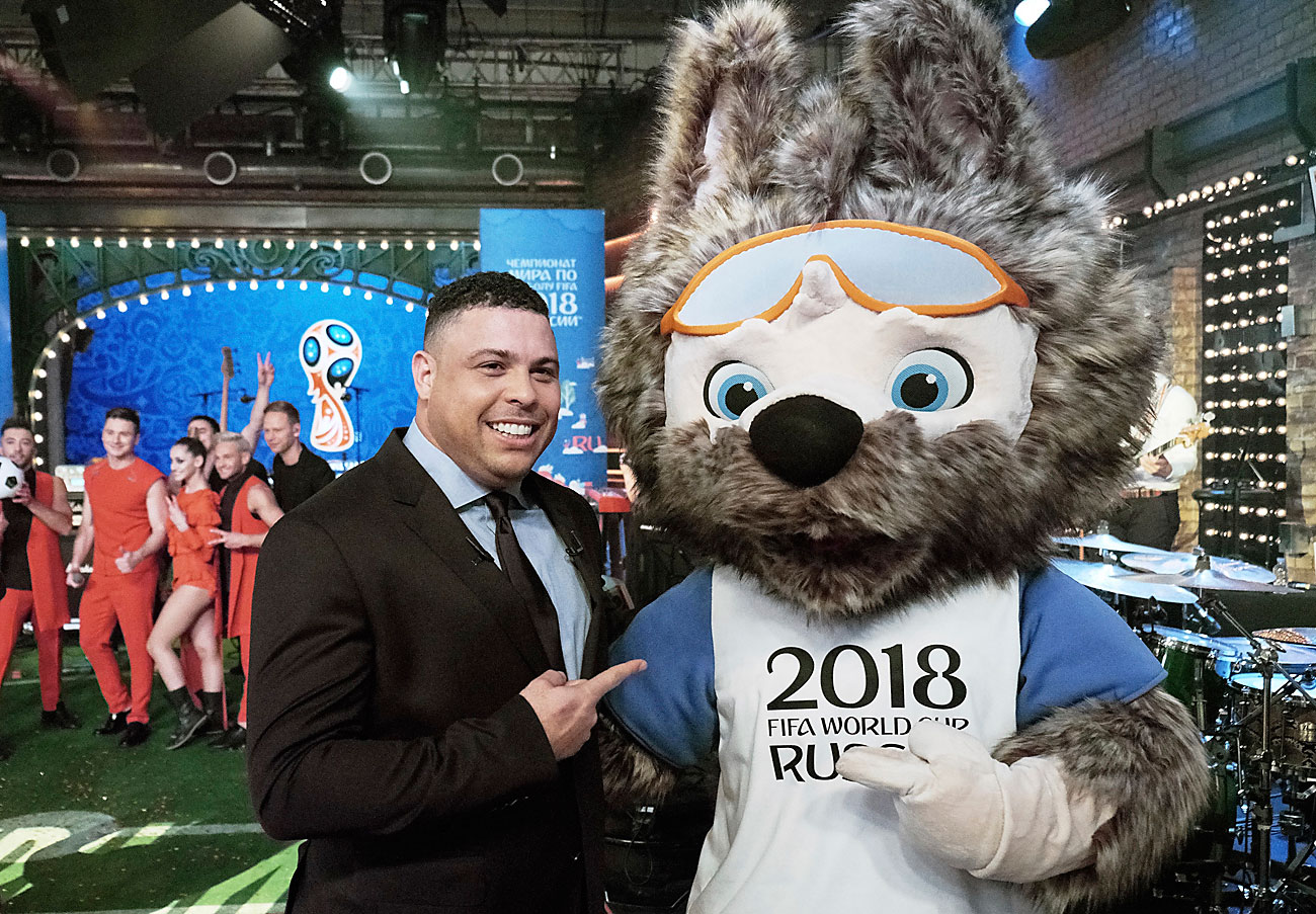 FIFA 2018 World Cup Russia official mascot, the wolf named Zabivaka, right, poses for a photo with former Brazilian soccer planer Ronaldo during a TV show on Russian Channel 1 in Moscow, Russia, Saturday, Oct. 22, 2016. Russia has chosen a cocky wolf wearing sporty goggles as the mascot for the 2018 football World Cup. The wolf was chosen in online voting over two other mascot candidates -- a cat and a tiger wearing a space suit.