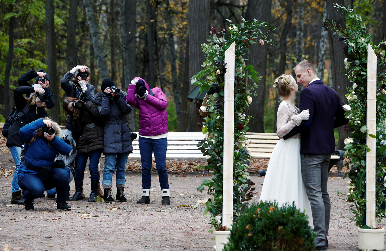 People take part in a photography class at a park in Moscow, Russia October 24, 2016.
