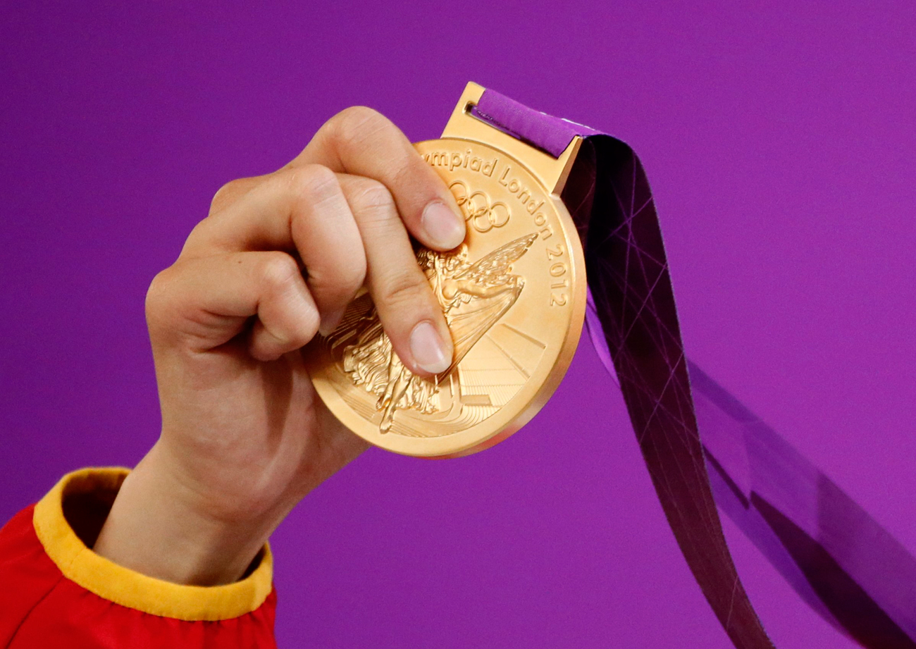 A number of Russian athletes have returned their medals after retests of their doping samples from the 2008 and 2012 Games tested positive for banned performance enhancing drugs.