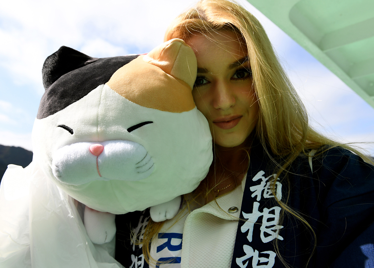 Miss Russia Alisa Manenok shows off her souvenir of a stuffed cat while boarding a boat at the Lake Ashinoko in Hakone town, Kanagawa prefecture. Seventy women will compete for the 2016 Miss International crown in Tokyo on October 27.