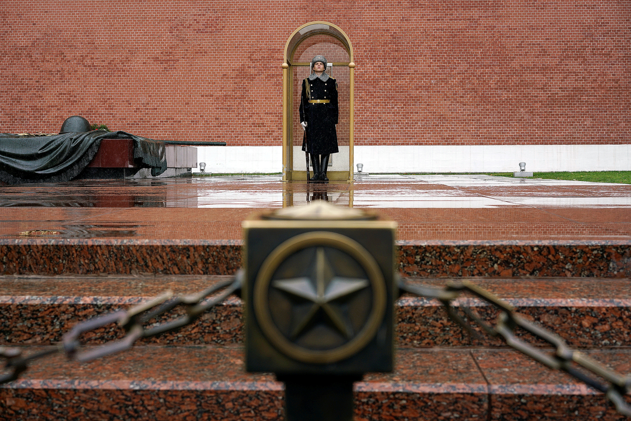 A honor guard stands at the Tomb of the Unknown Soldier by the Kremlin wall in central Moscow, Russia