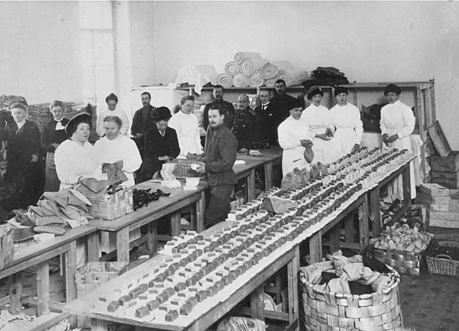 She made sure that some public taxes went to the Red Cross society. During the First World War, 10 cents from the price of every telegram were sent to the Red Cross. / Red Cross workers packing soap.