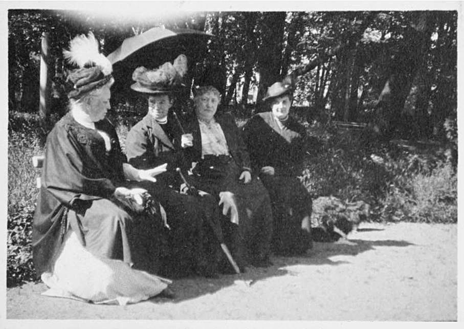 Around 700,000 people received help at Maria Fyodorovna's hospitals, orphanages, and schools. / Maria Fyodorovna in a garden with women charity workers.