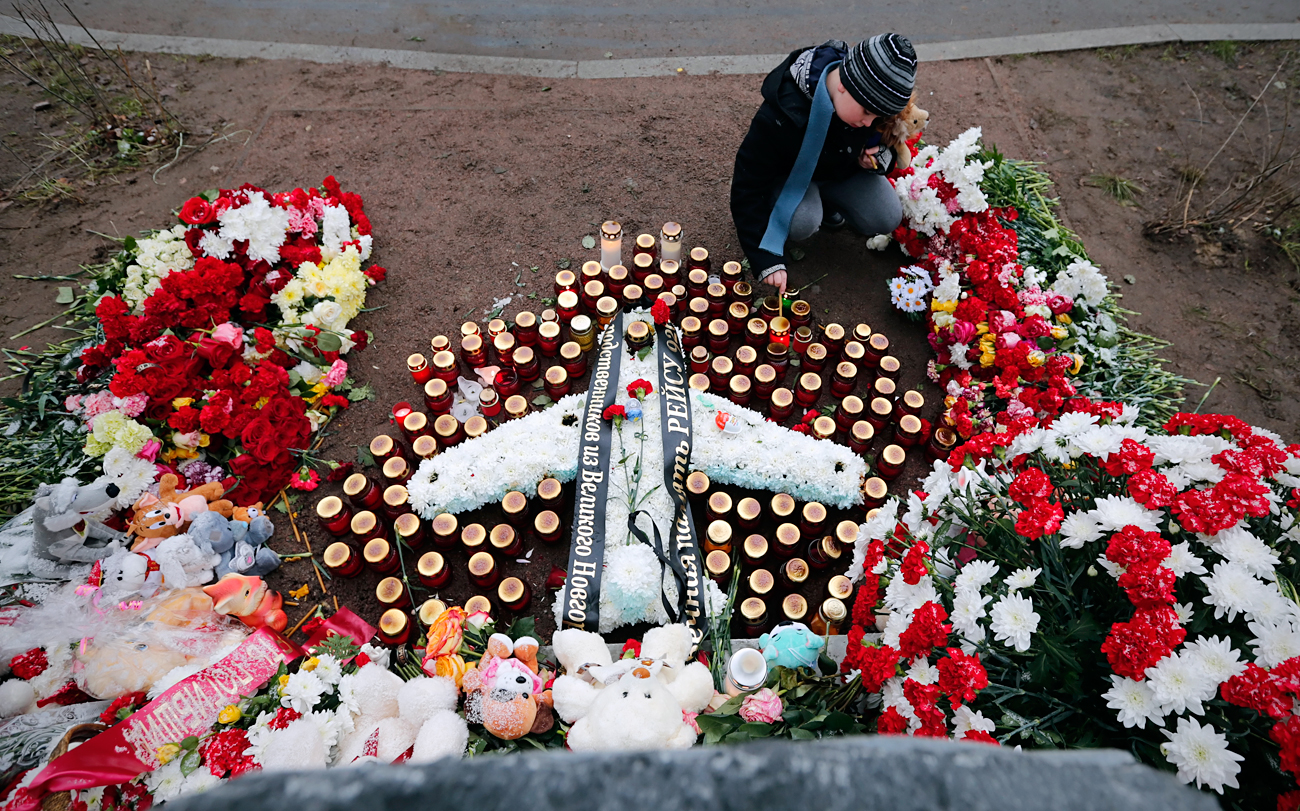 A boy lays candles in front of the foundation stone for a commemorating the 224 people, who were killed in the bombing of a Russian airliner over Sinai, Egypt, in Vsevolozhsk, outside St. Petersburg, Russia, 31 October 2016. An Airbus A321 plane of Russian MetroJet airline in route from Sharm-el-Sheikh in Egypt to St. Petersburg crashed in the Sinai, Egypt, on 31 October 2015, killing all 224 people on board.