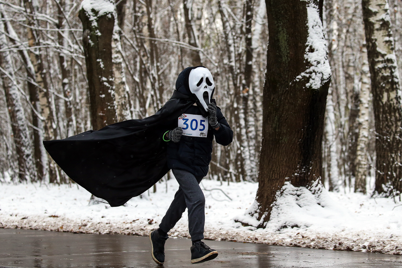 A participant in All Saints Run, a charity running event, during Halloween celebrations in Moscow's Kuzminki Park