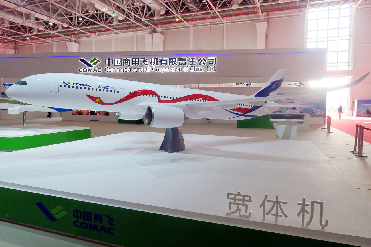A model of a wide-body commercial jet being developed by China's COMAC (Commercial Aircraft Corp of China) and Russia's United Aircraft Corporation is on display during the 11th China International Aviation and Aerospace Exhibition, also known as Airshow China 2016.