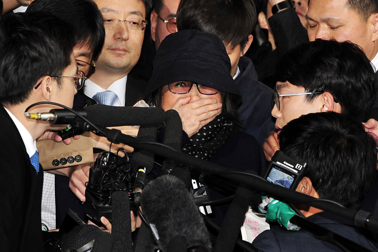 Choi Soon-sil (C), who is alleged of having meddled in state affairs and peddled influence on various state projects by exploiting her friendship with South Korean President Park Geun-hye, as she arrives to the Seoul Central District Prosecution Office for questioning in Seoul.