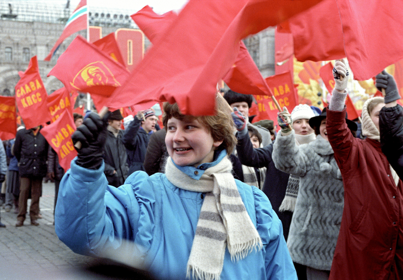 Demonstrators celebrate the 69th anniversary of the October Revolution.