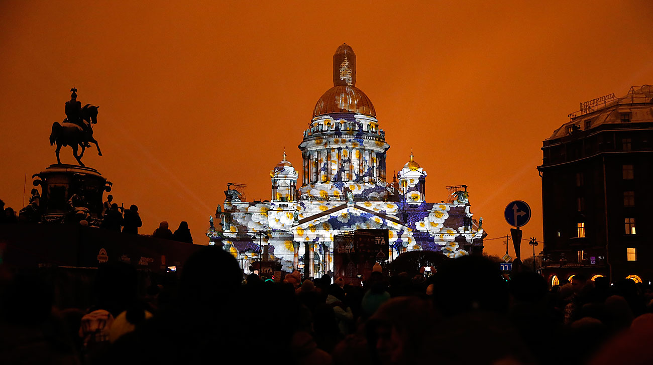 The bronze equestrian Monument to Nicholas I of Russia (L) and illuminated St. Isaac's Cathedral during a light show in central St. Petersburg on Nov. 5.