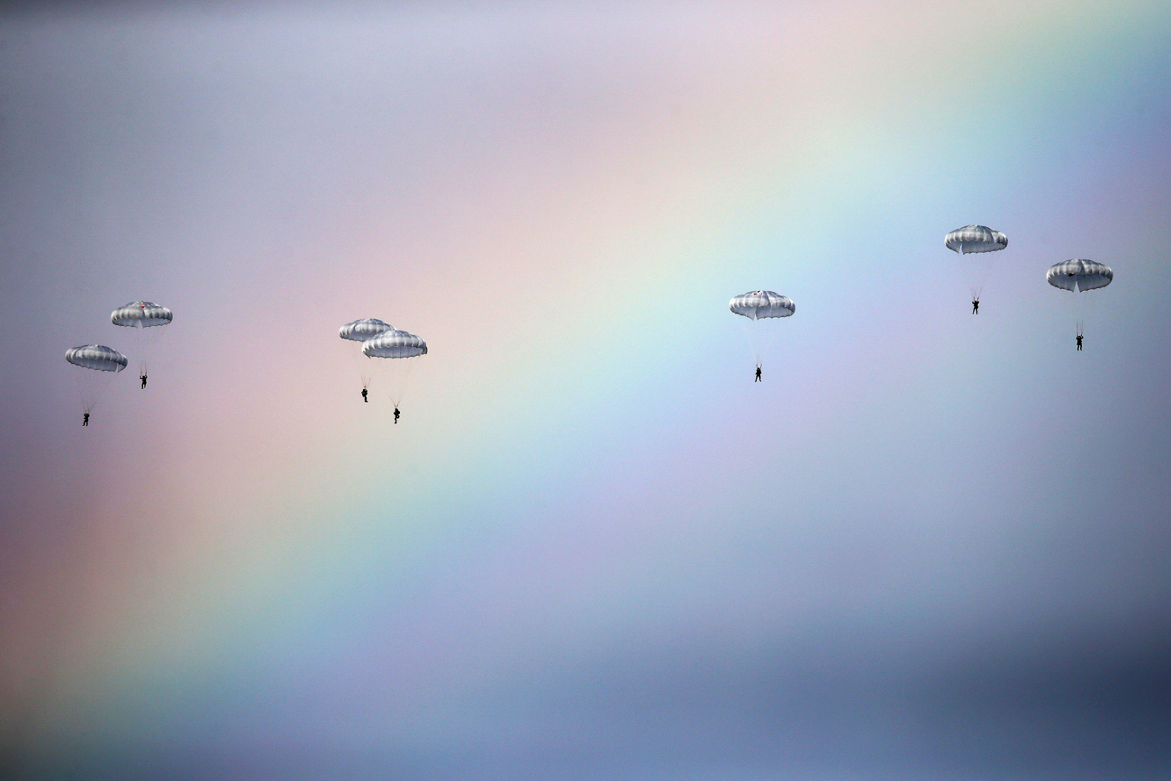 "Russian paratroopers jump past rainbow from an IL-76 transport plane during a joint Serbian-Russian military training exercise ""Slavic Brotherhood"" in the town of Kovin, near Belgrade, Serbia."