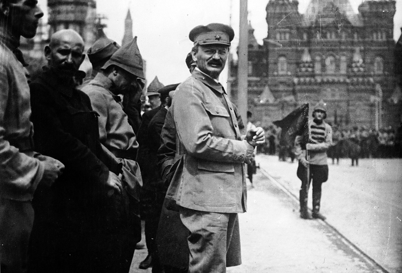 1918: Leon Trotsky attends a parade in Red Square, Moscow, as Lenin reviews his troops.