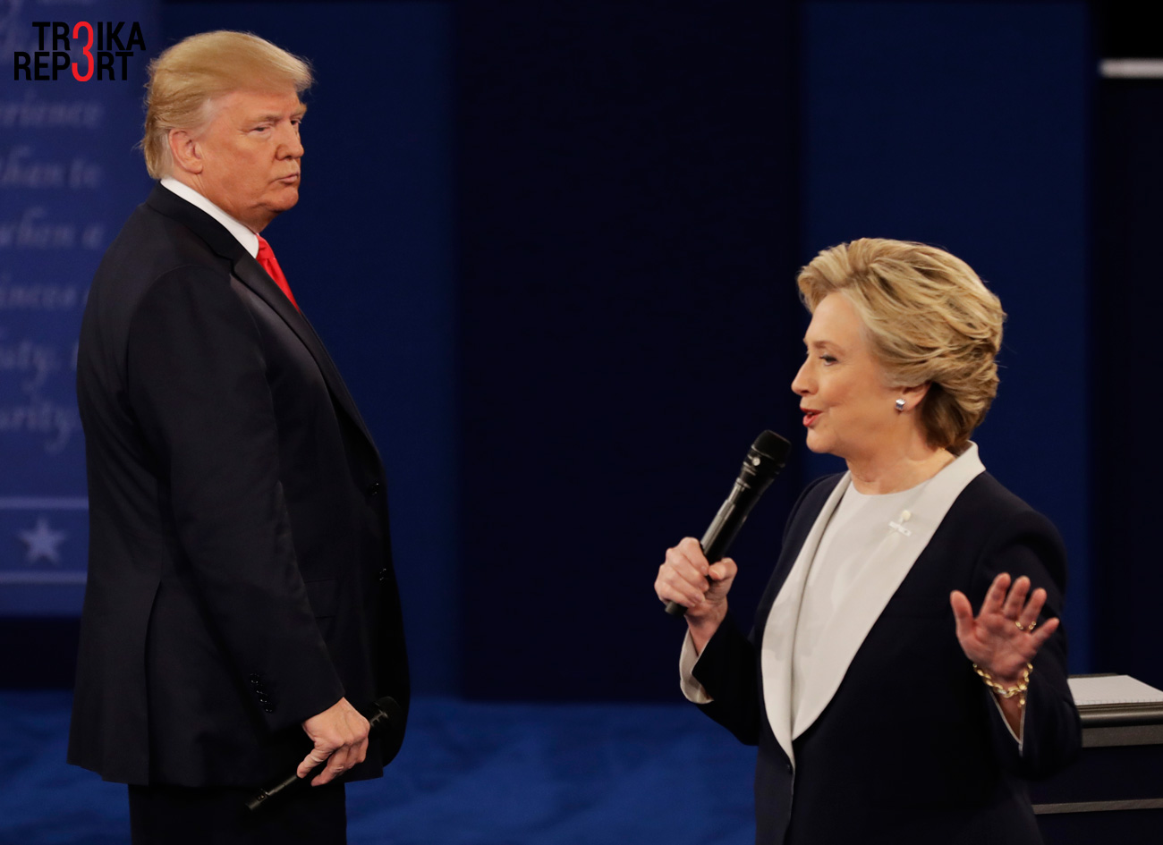 Republican presidential nominee Donald Trump listens to Democratic presidential nominee Hillary Clinton during the second presidential debate at Washington University in St. Louis.
