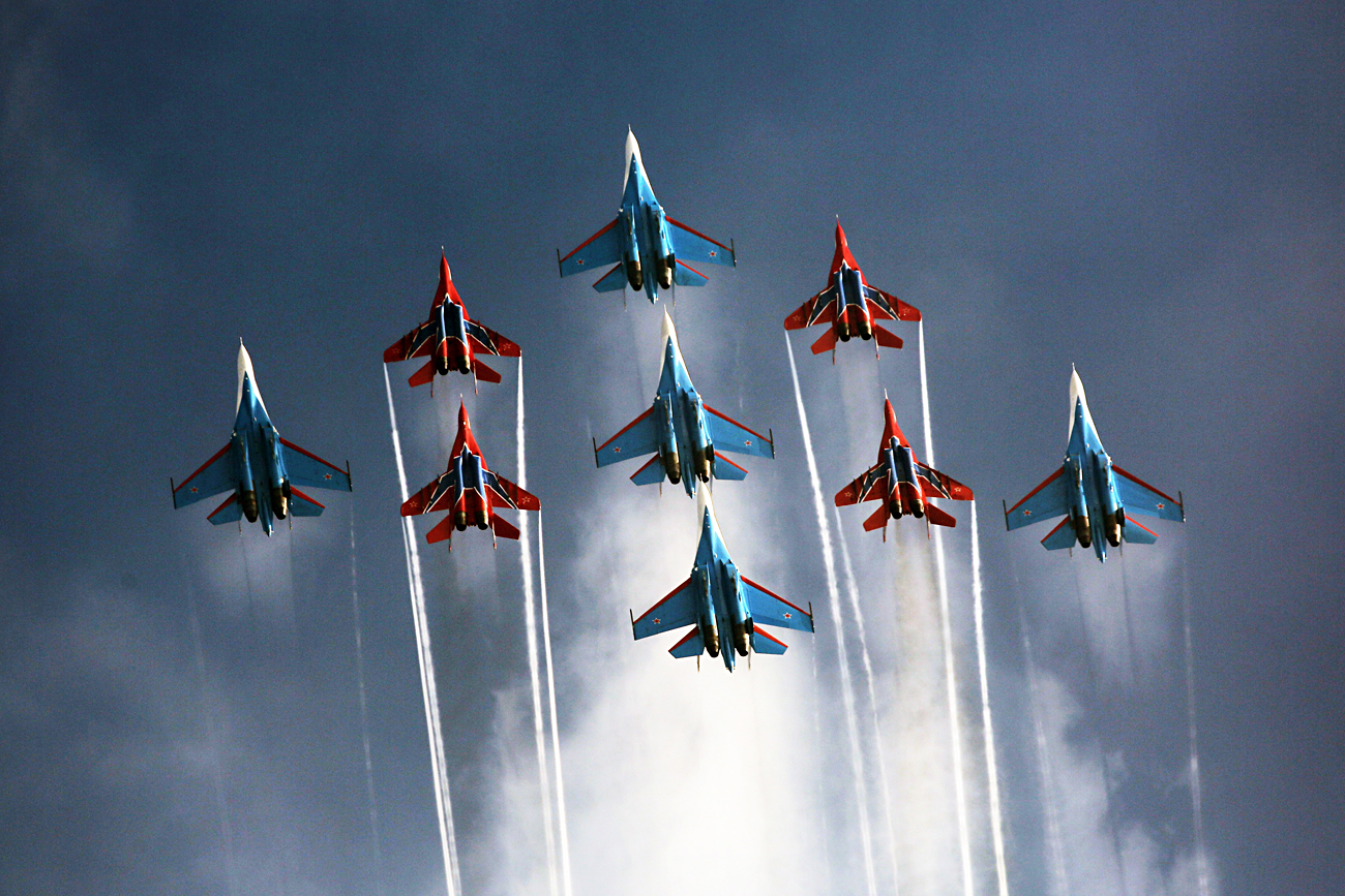 Mikoyan Mig 29 fighter jets of the Strizhi  aerobatic team and Sukhoi Su 27 fighter jets of the Russkiye Vityazi