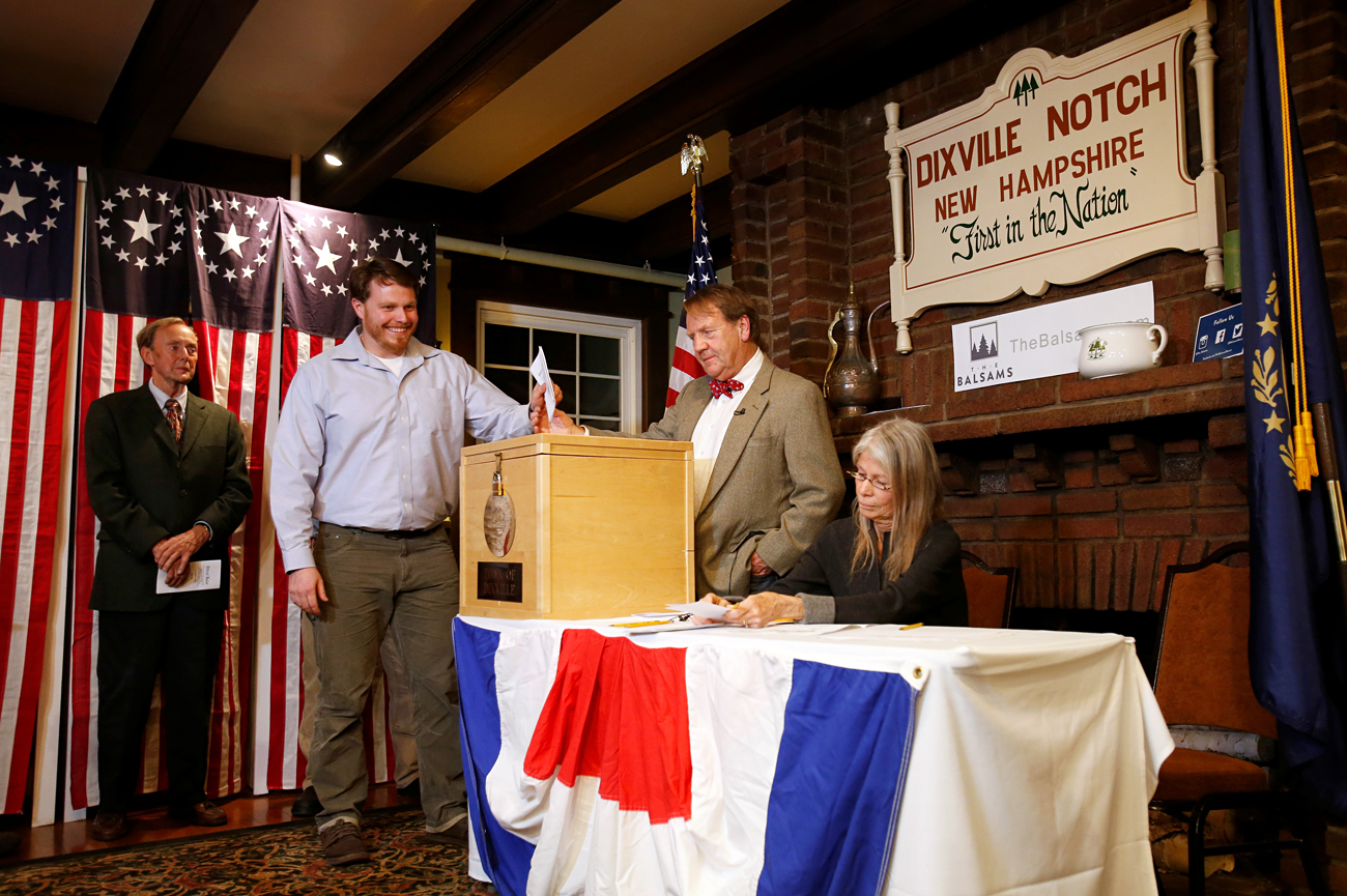 Clay Smith is the first to cast his ballot in the U.S. presidential election at midnight in tiny Dixville Notch, New Hampshire, November 8, 2016.