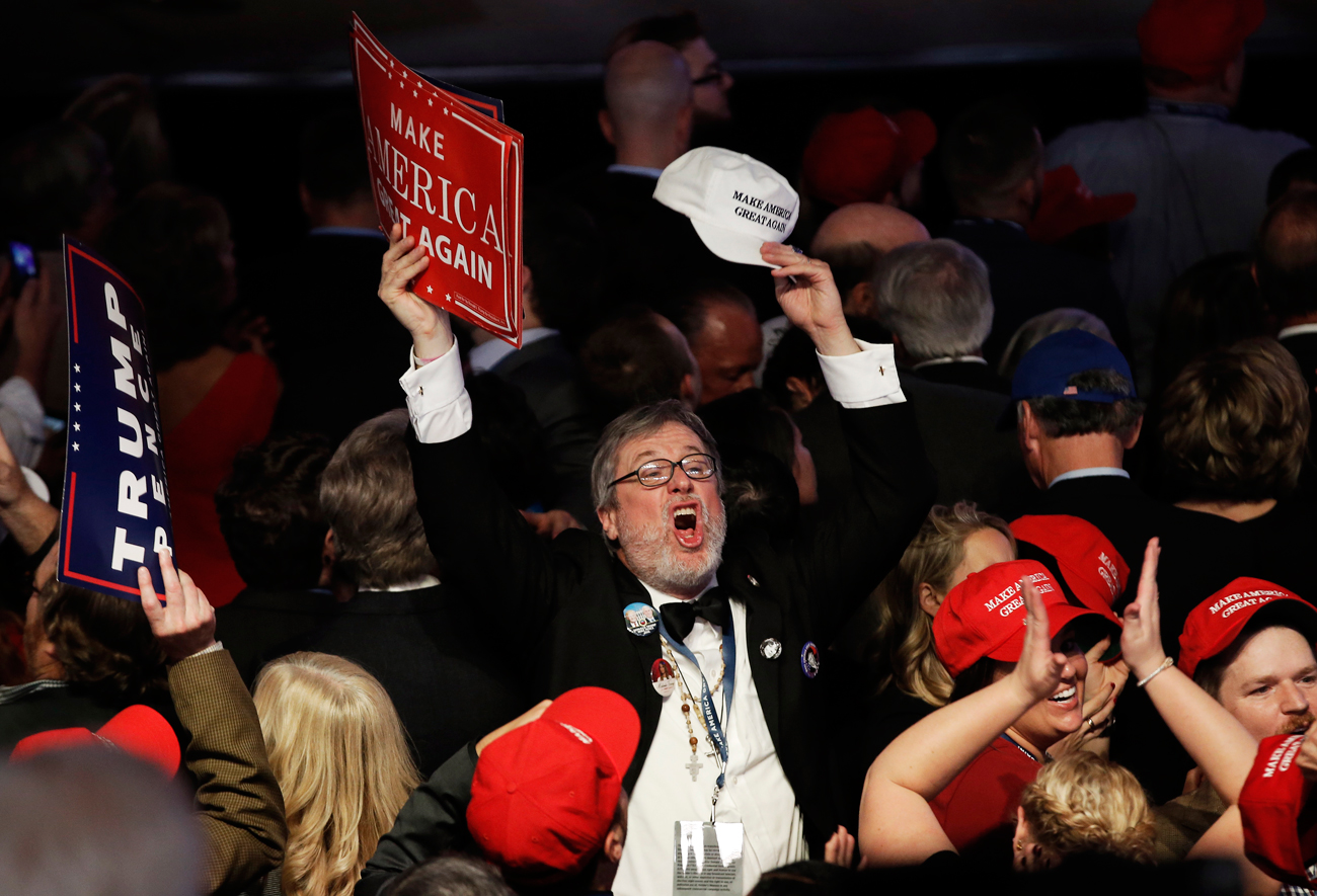 A supporter celebrates as returns come in for Republican U.S. presidential nominee Donald Trump during an election night rally in Manhattan, New York, U.S., Nov. 8, 2016.