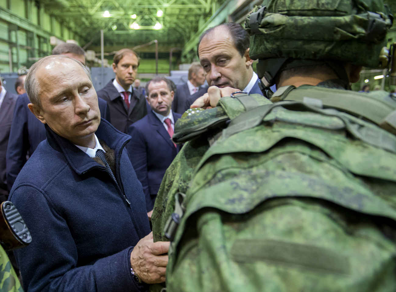 Russian President Vladimir Putin, left, reviews examples of 'Ratnik' modern military garment during a working visit to OJSC 'Kalashnikov Concern' in Izhevsk.
