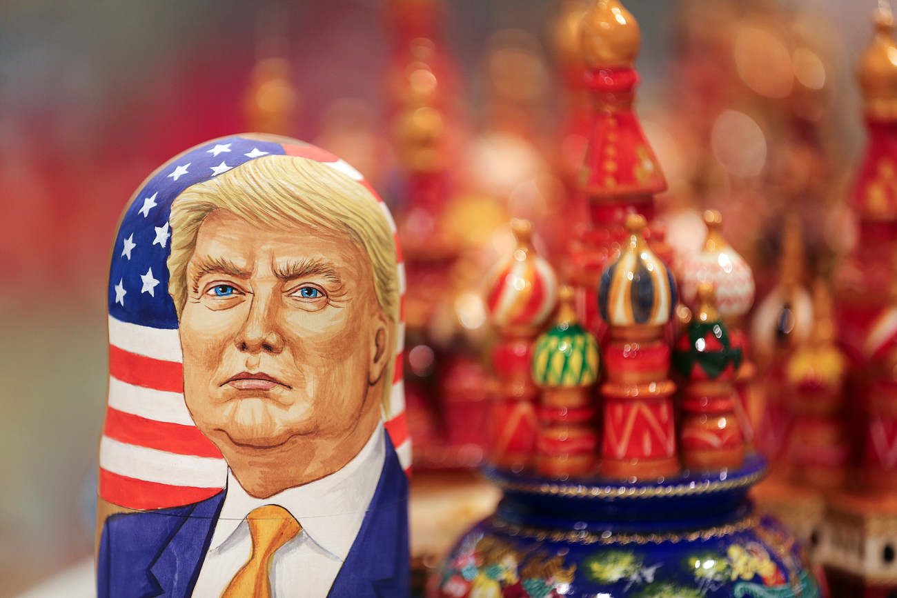 A martyoshka doll showing Donald Trump, U.S. president elect, sits beside painted wooden models of St. Basil's cathedral in a souvenir store in Moscow.