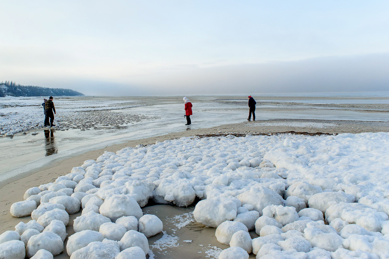 A view of numerous giant ice balls on the shore of the Gulf of Ob, a bay between the Gydan and Yamal peninsulas. Ranging in size from 10 to 25 cm [~4-10 in] and relatively regular in shape, the ice balls form as snow slush and pieces of shore-fast ice are washed by waves