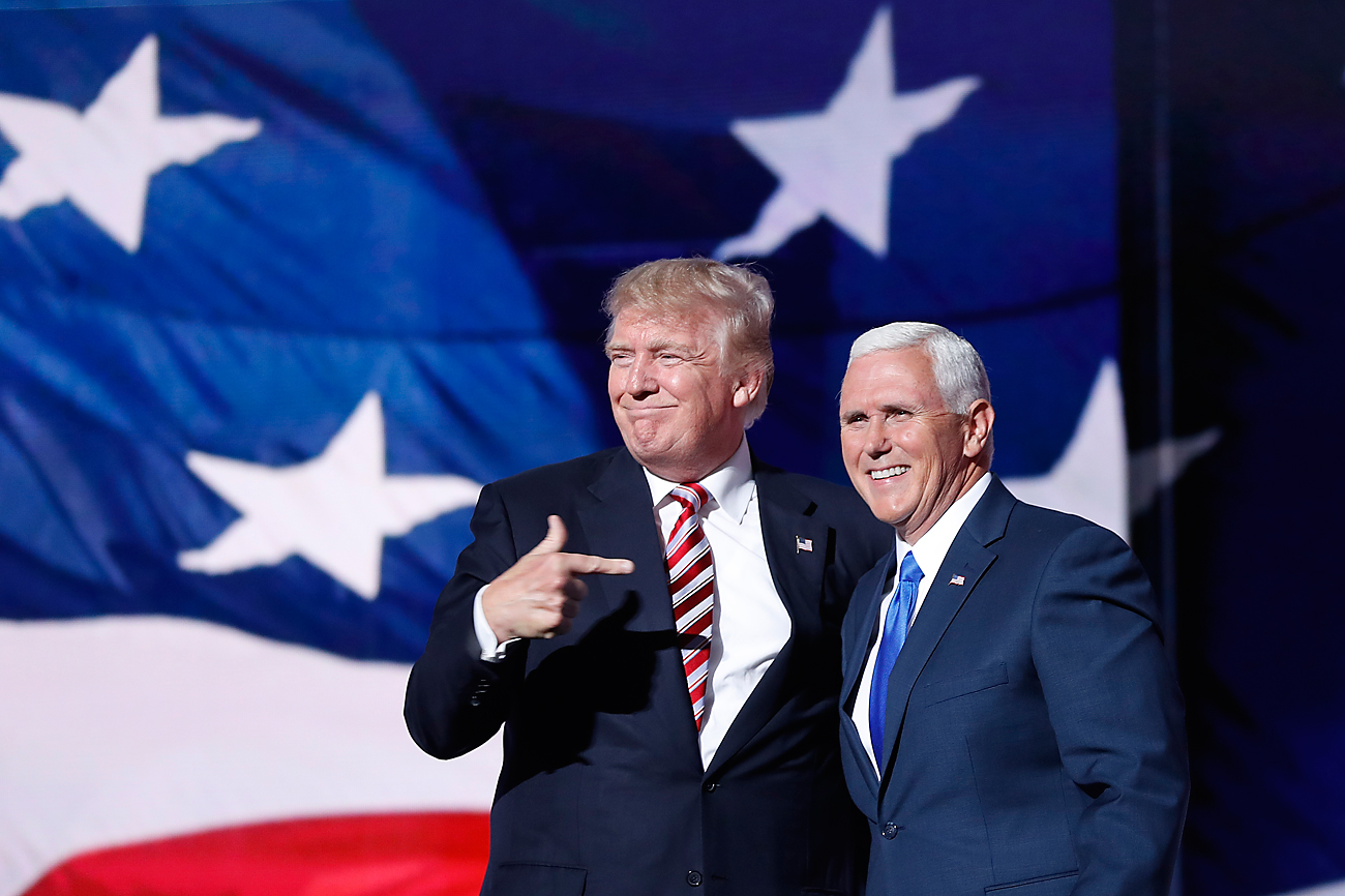 Republican presidential Candidate Donald Trump, points toward Republican Vice presidential candidate Gov. Mike Pence of Indiana after Pence's acceptance speech during the third day session of the Republican National Convention in Cleveland, Wednesday, July 20, 2016.