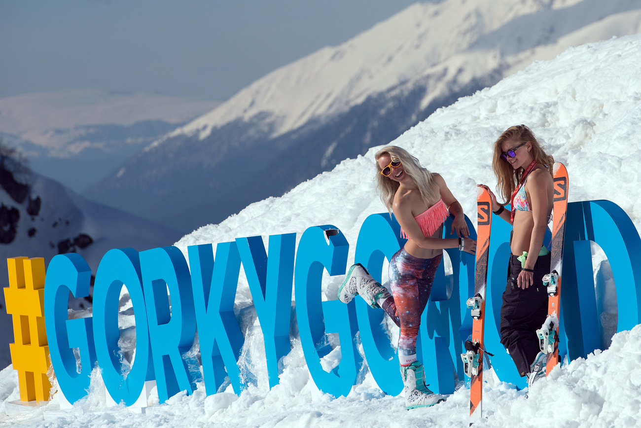 Girls pose for a photograph in the 2016 Quiksilver New Star Сamp at the Gorky Gorod ski resort in Krasnaya Polyana.