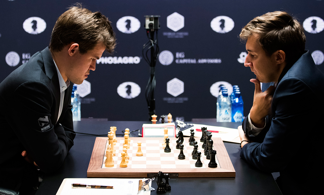Chess players Magnus Carlsen (L) of Norway, the reigning world chess champion, and Sergey Karjakin of Russia contemplate their moves during round 1 of the World Chess Championship in New York. The players will face off in 12 games between today and Nov. 30 2016.
