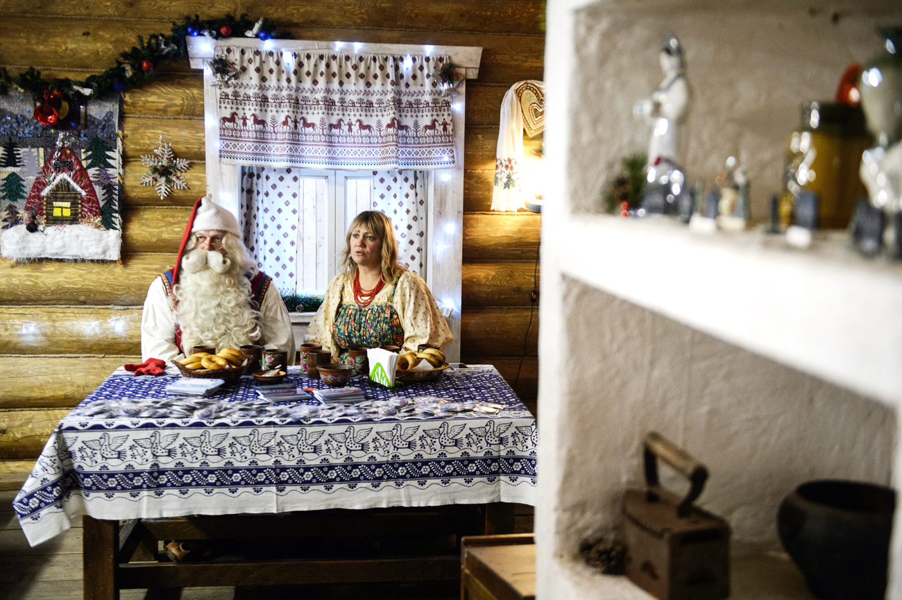 Joulupukki [the Finnish Santa Claus], L, and Park Skazov theme park director Natalya Larionova in Park Skazov Russian fairy-tale and traditional Urals folk culture park