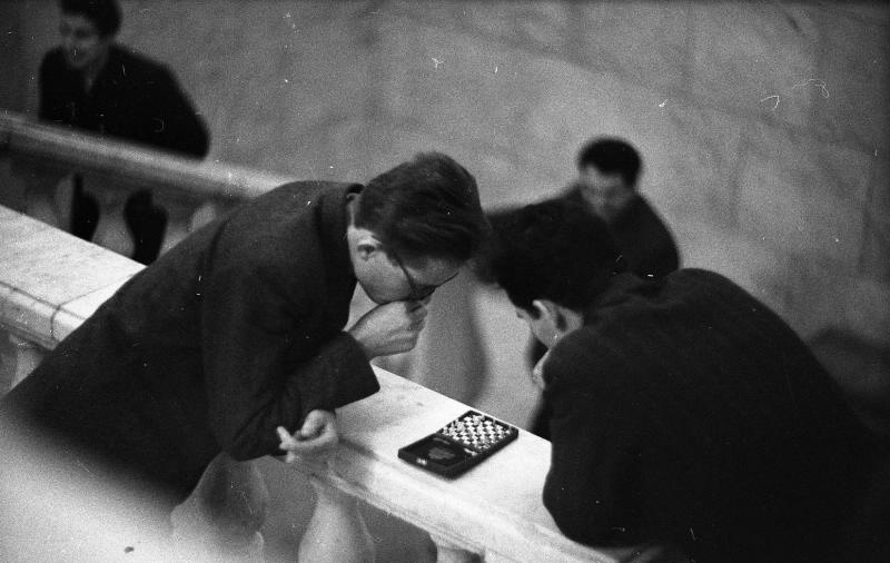 1963-1964. Moscow. Students play pocket chess between classes.