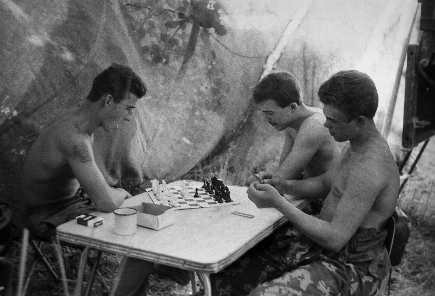 1985. Soviet Army soldiers deployed in Afghanistan during the Soviet-Afghan War play chess at their camp in Nangarhar Province.