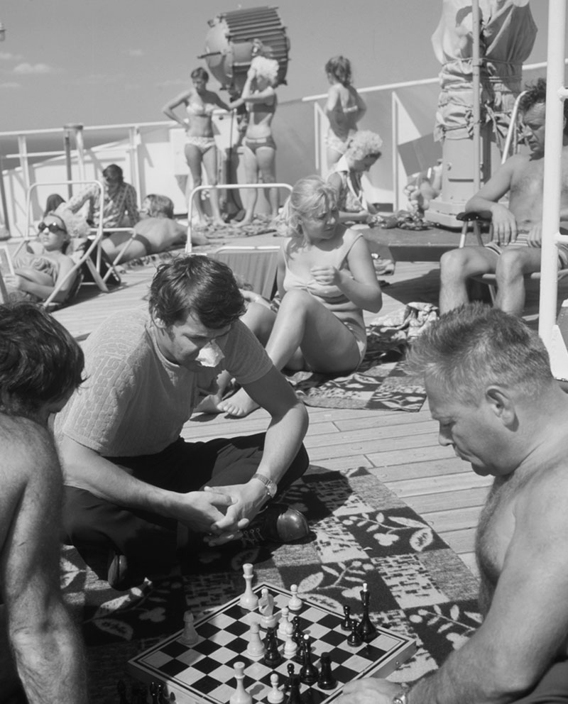 1973. Passengers on board a cruise from Leningrad (now St. Petersburg) to New York relax on the top deck of the ship.