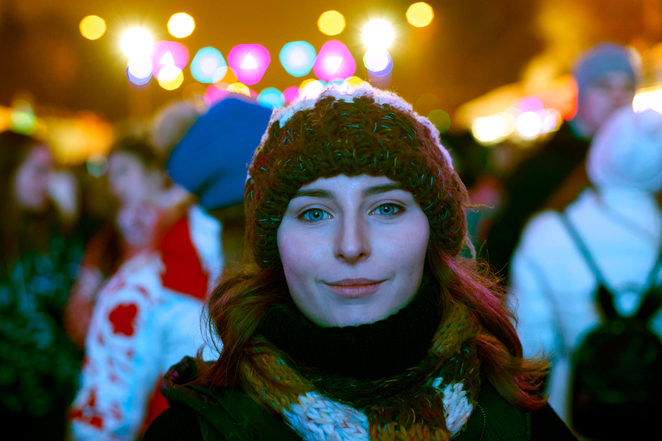 A young woman smiles as she attends the opening of a skating rink in the Gorky park in Moscow, Russia, on Thursday, Nov. 17, 2016. Skating, the popular winter fun, has come to Moscow's streets again as winter takes its place.
