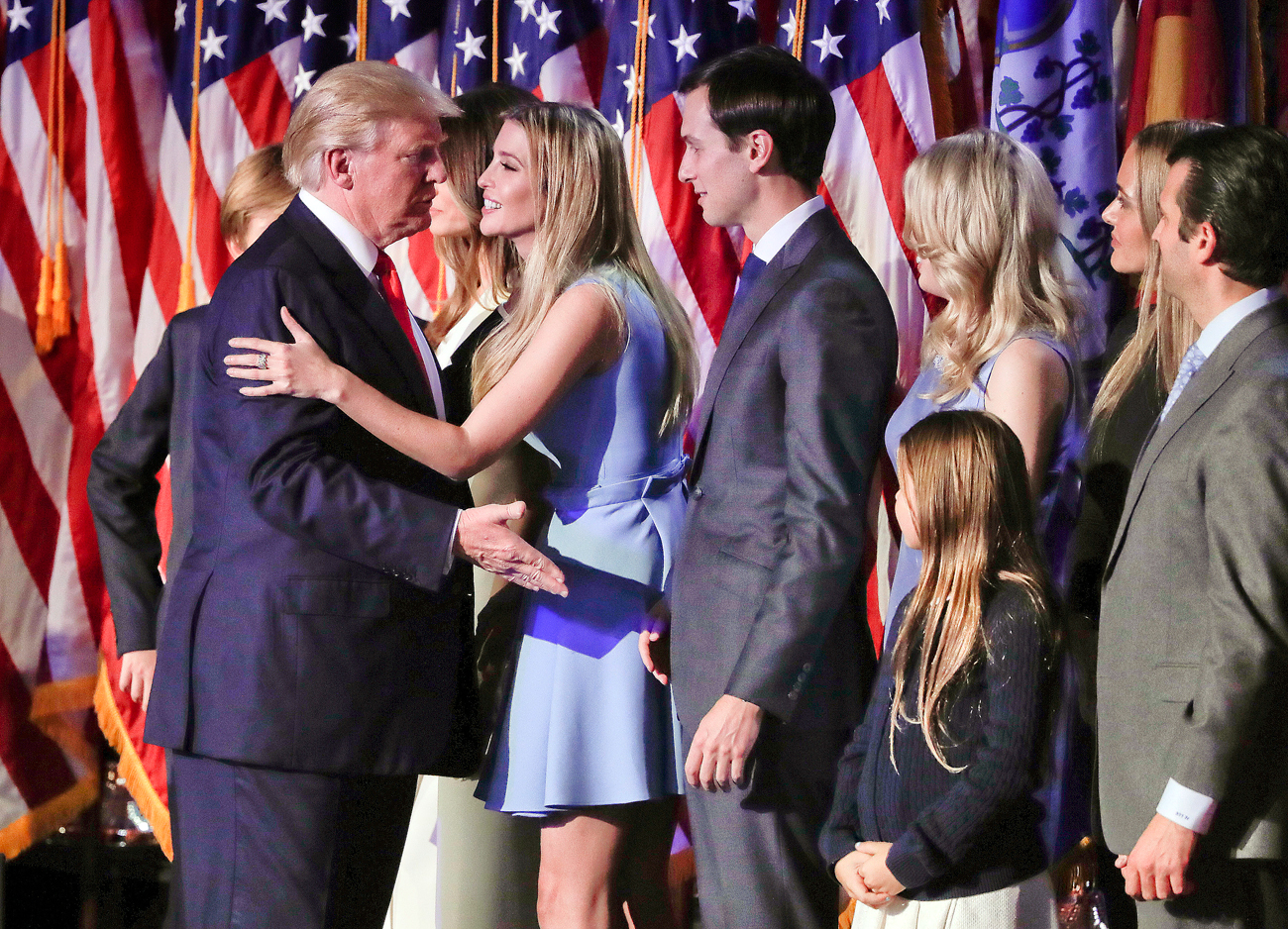 President elect Donald Trump (L) greets his daughter, Ivanka Trump, after giving his acceptance speech at an election night rally. Ivanka's husband Jared Kushner stands right next to her.
