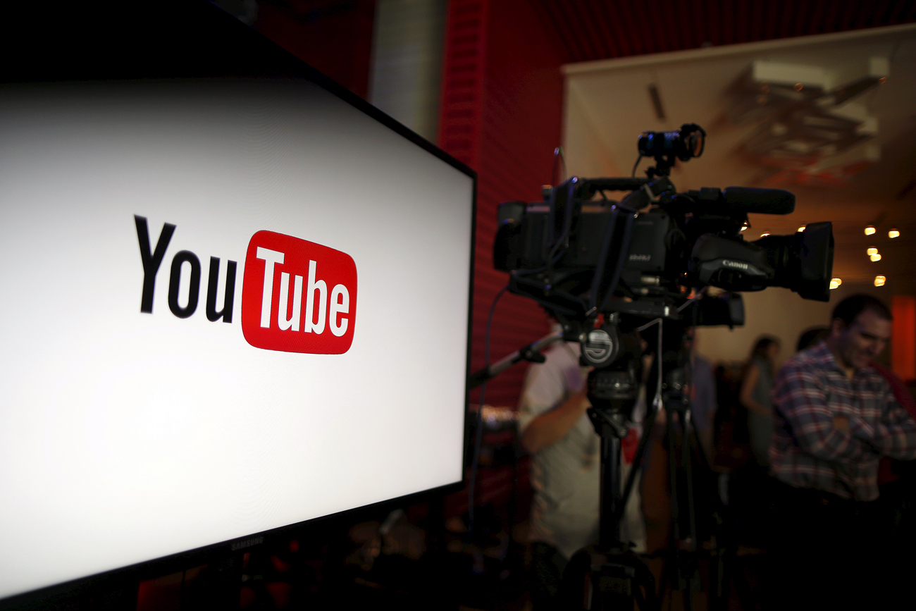 Alphabet Inc's YouTube will launch a $10-a-month subscription option in the United States on October 28 that will allow viewers to watch videos from across the site without interruption from advertisements, the company said