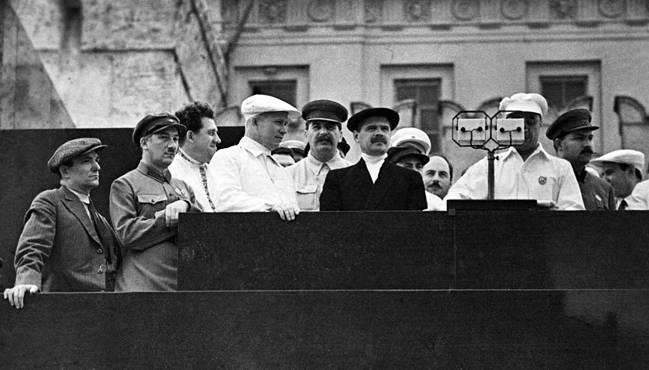 Moscow. USSR. Football player Nikolai Starostin, People's Commissar (Narkom) for Internal Affairs (NKVD) Genrikh (Henry) Yagoda, First Secretary of the Moscow City Committee of the All-Union Communist Bolsheviks' Party Nikita Khrushchev, Secretary of the Communist Party of the Soviet Union Joseph Stalin, People's Commissar (Narkom) for Transport of the Soviet Union Lazar Kaganovich and member of the Politburo Andrei Andreyev (L-R) standing on the tribune of Lenin's Mausoleum during a Parade of Athletes.