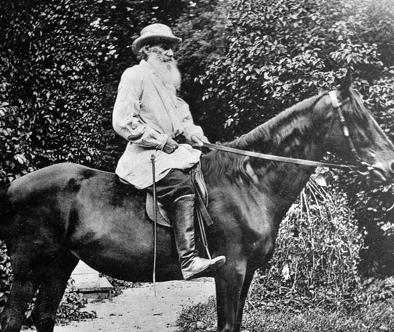 Leo Tolstoy riding a horse in Yasnaya Polyana