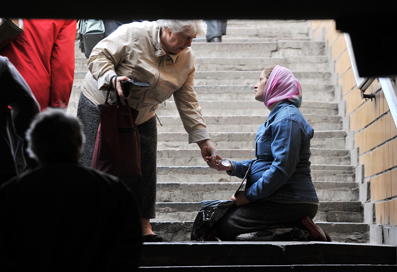 A woman begs in one of the subway underpasses in Moscow.