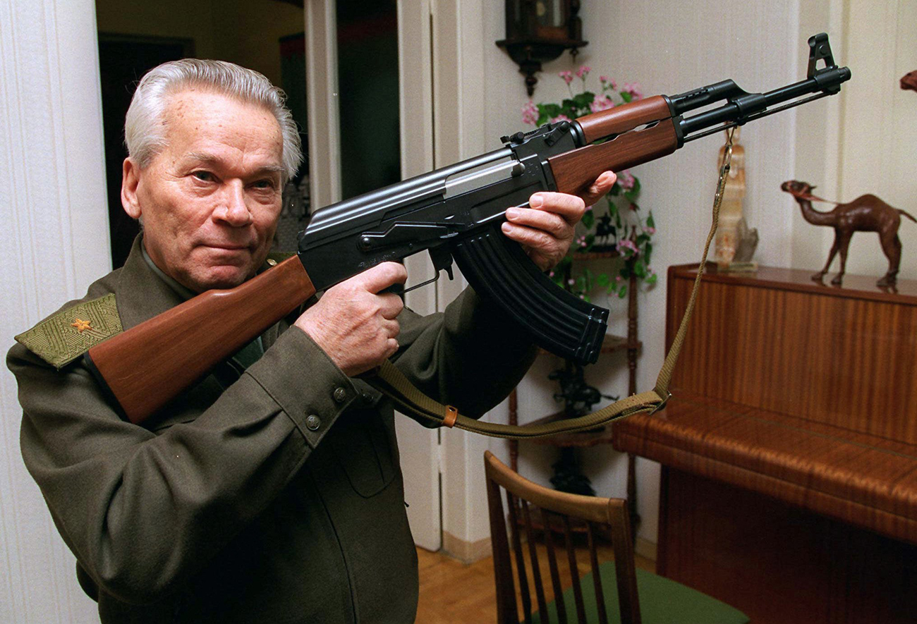 Mikhail Kalashnikov shows a model of his world-famous AK-47 assault rifle at home in the Ural Mountain city of Izhevsk, 1000 km (625 miles) east of Moscow.