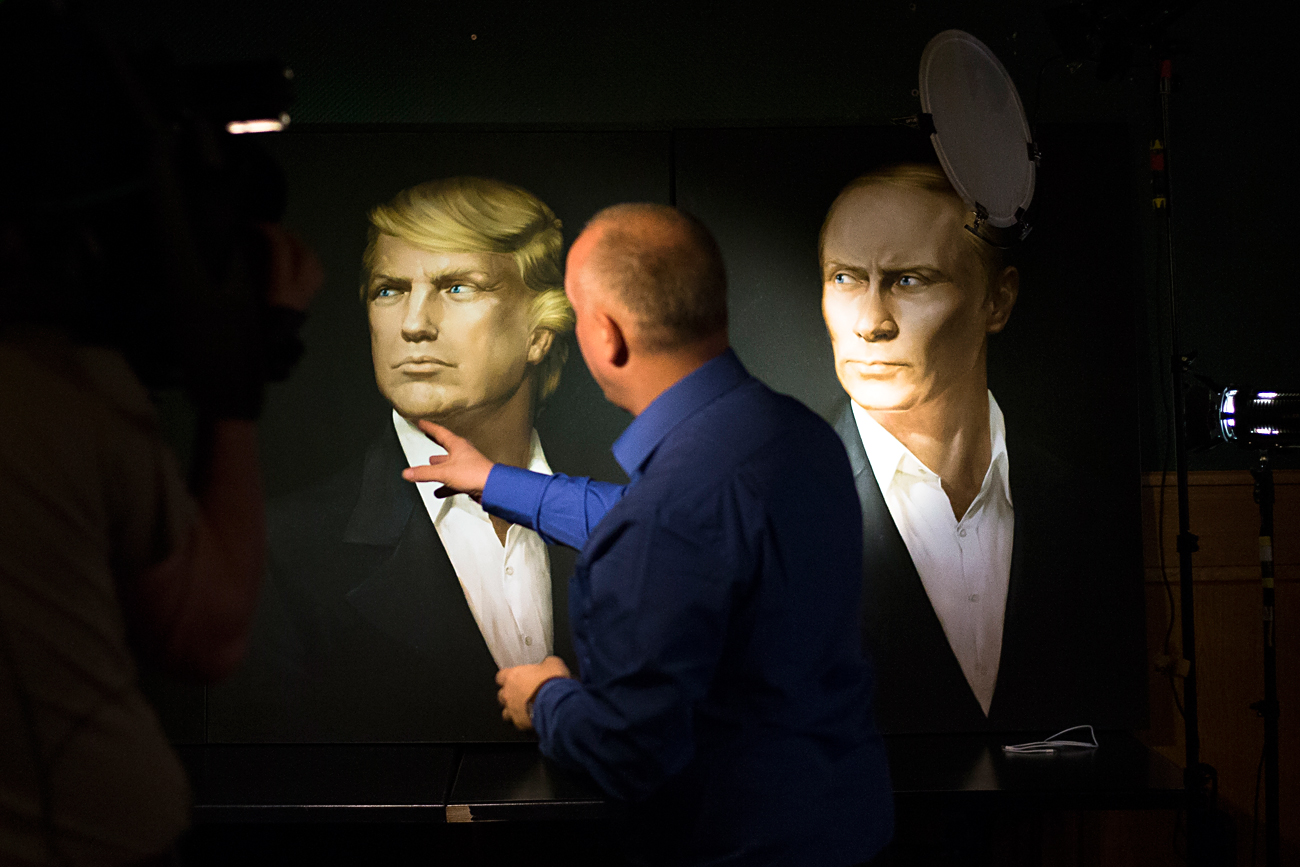 A portrait of U.S. President-elect Donald Trump, with a portrait of Russian President Vladimir Putin during a live telecast of the U.S. presidential election in the Union Jack pub in Moscow, Russia, Nov. 9, 2016.
