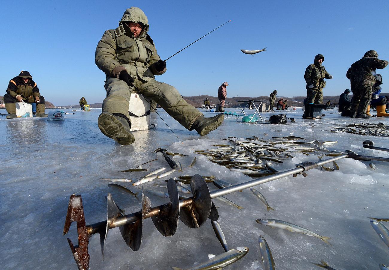 Fishermen during ice fishing in Vladivostok.